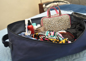 SEVEN TRAVEL ESSENTIALS FOR PROFESSIONAL WOMEN